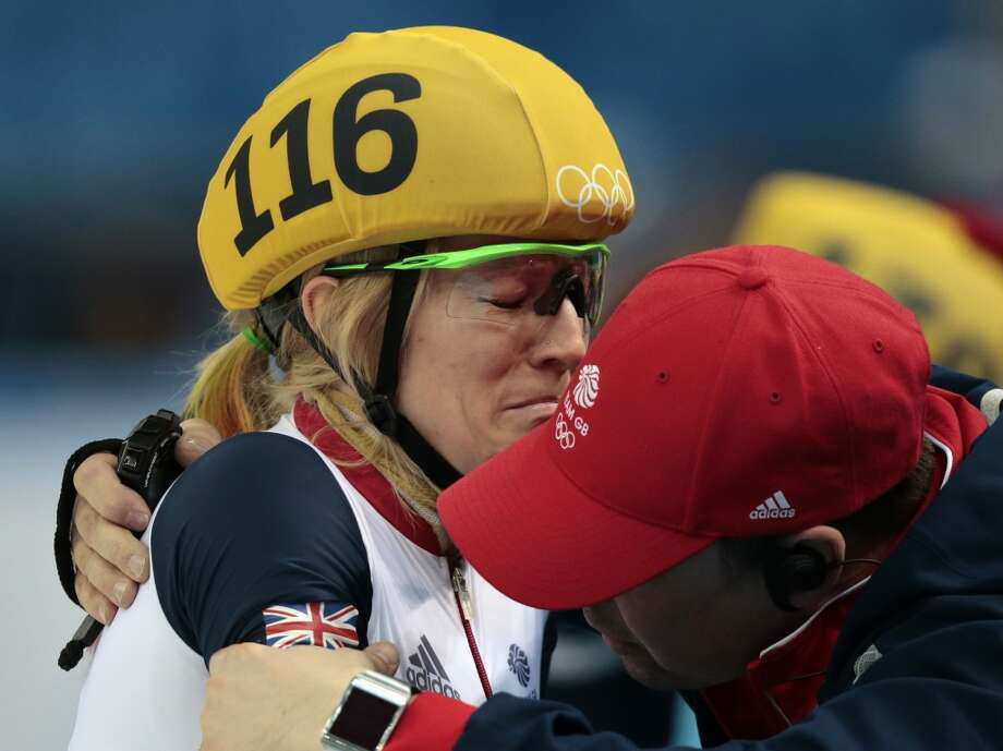 Elise Christie of Britain cries after she was penalised for impeding in the women's 500m short track speedskating final at the Iceberg Skating Palace during the 2014 Winter Olympics, Thursday, Feb. 13, 2014, in Sochi, Russia. Photo: Ivan Sekretarev, Associated Press