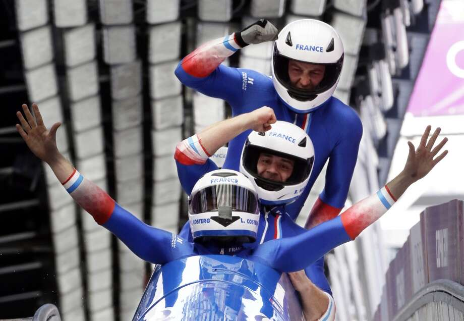 The team from France FRA-1, with Loic Costerg, Romain Heinrich, Florent Ribet and Elly Lefort, react after their final run during the men's four-man bobsled competition final at the 2014 Winter Olympics, Sunday, Feb. 23, 2014, in Krasnaya Polyana, Russia. Photo: Dita Alangkara, Associated Press