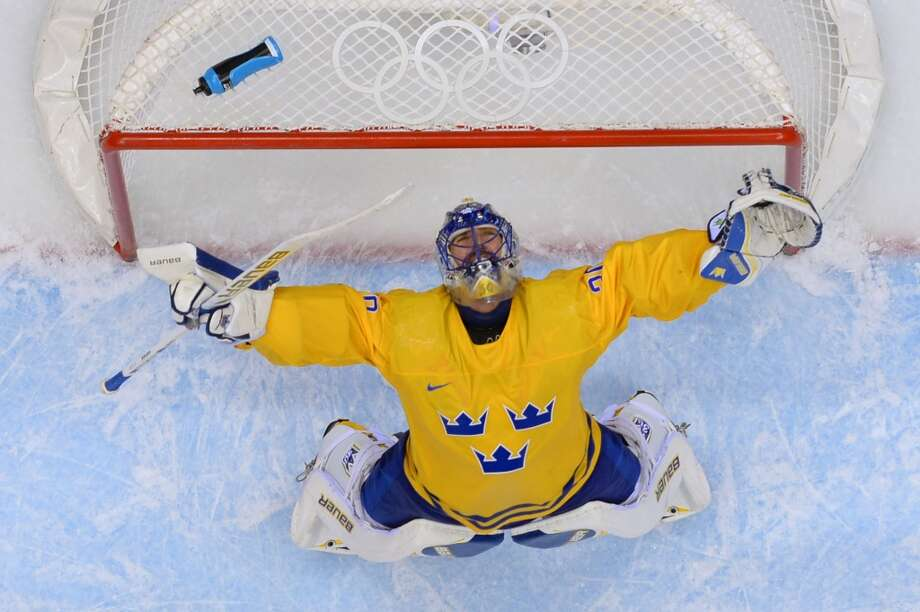 Sweden's goalkeeper Henrik Lundqvist celebrates at the end of the Men's Ice Hockey Semifinal match between Sweden and Finland at the Bolshoy Ice Dome during the Sochi Winter Olympics on February 21, 2014. Sweden won 2-1. Photo: ALEXANDER NEMENOV, AFP/Getty Images