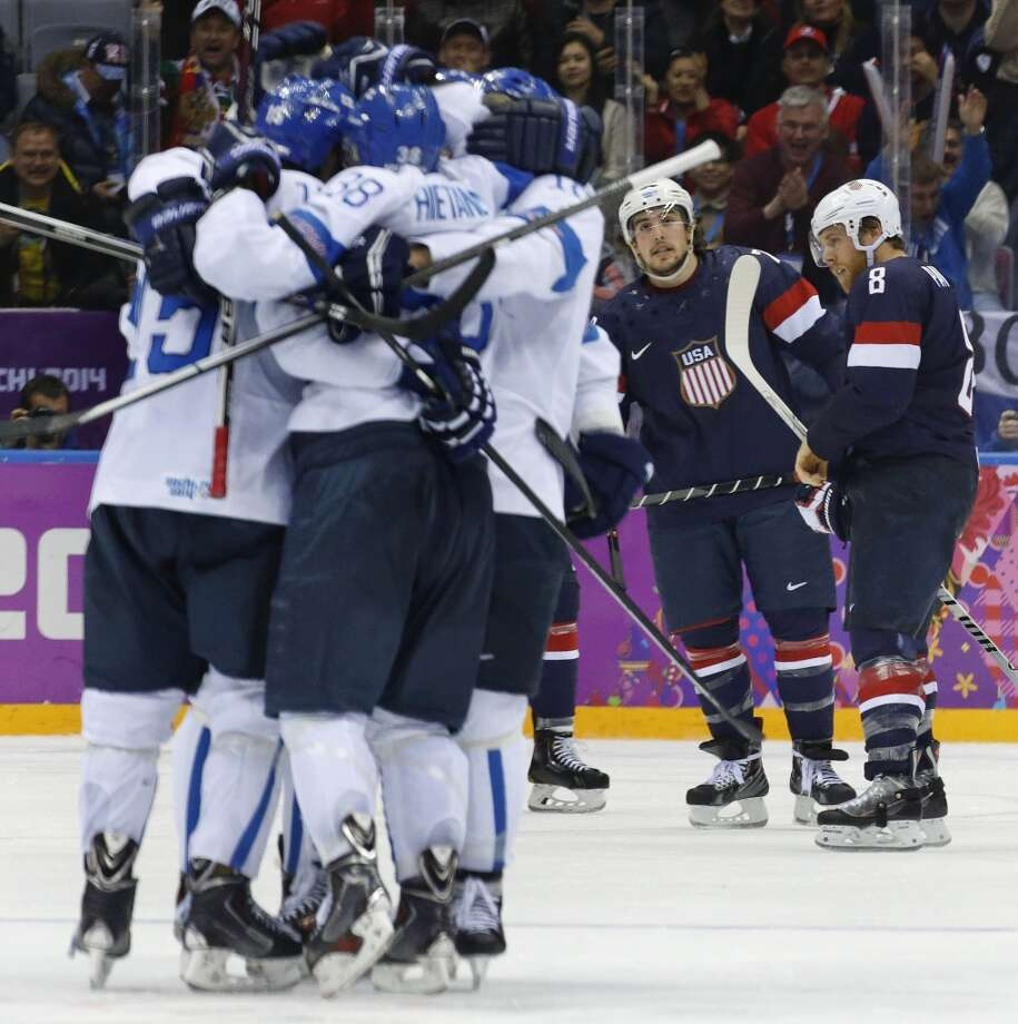 USA defenseman Justin Faulk and forward Joe Pavelski react as Finland celebrates a goal during the third period of the men's bronze medal ice hockey game at the 2014 Winter Olympics, Saturday, Feb. 22, 2014, in Sochi, Russia. Photo: Mark Humphrey, Associated Press