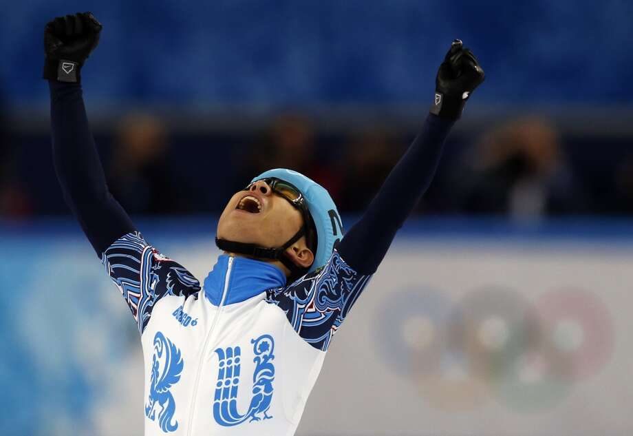 Russia's Victor An celebrates winning the gold medal in the Men's Short Track 1000 m Final at the Iceberg Skating Palace during the Sochi Winter Olympics on February 15, 2014. Photo: ADRIAN DENNIS, AFP/Getty Images