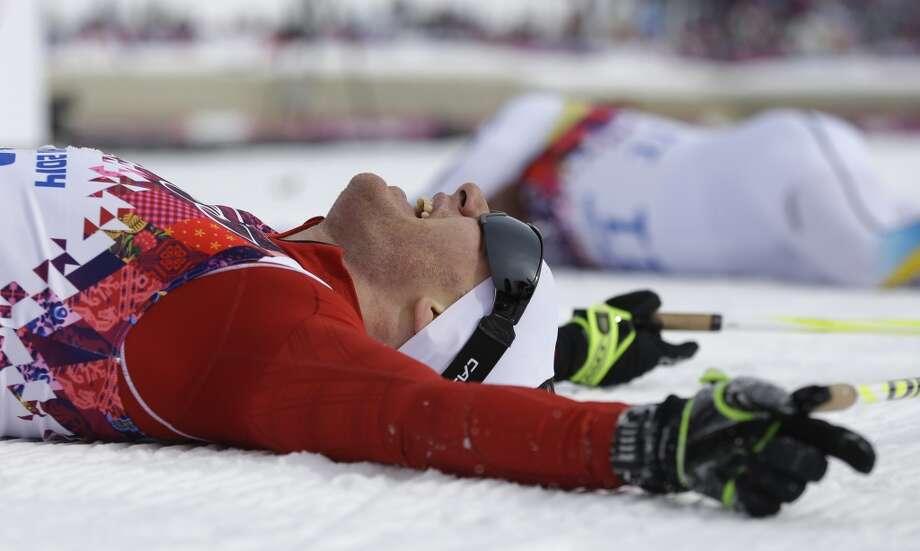 Switzerland's Dario Cologna celebrates winning the men's cross-country 30k skiathlon at the 2014 Winter Olympics, Sunday, Feb. 9, 2014, in Krasnaya Polyana, Russia. Photo: Gregorio Borgia, Associated Press