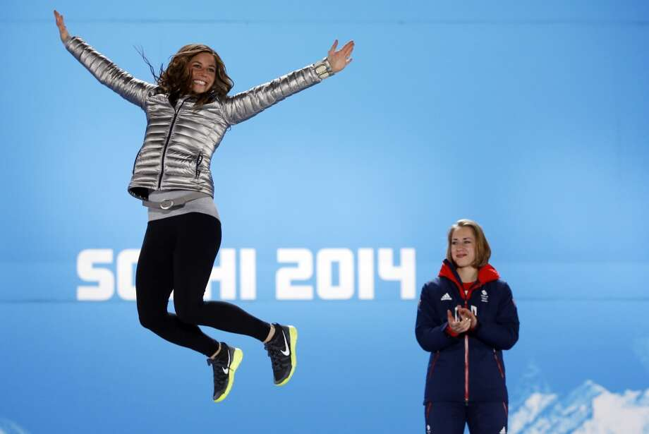 US silver medalist Noelle Pikus-Pace (L) poses on the podium as Great Britain's gold medalist Elizabeth Yarnold looks on during the Women's Skeleton Medal Ceremony at the Sochi medals plaza during the Sochi Winter Olympics on February 15, 2014. Photo: ADRIAN DENNIS, AFP/Getty Images