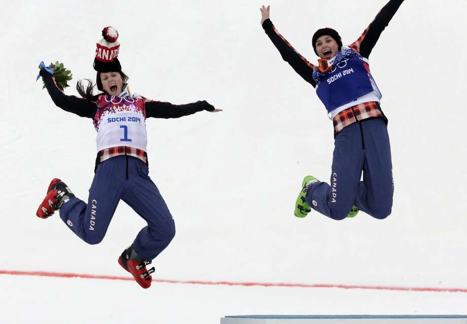 Women's ski cross gold medalist Marielle Thompson of Canada, right, celebrates on the podium with silver medalist and compatriot Kelsey Serwa, left, at the Rosa Khutor Extreme Park, at the 2014 Winter Olympics, Friday, Feb. 21, 2014, in Krasnaya Polyana, Russia. Photo: Andy Wong, Associated Press