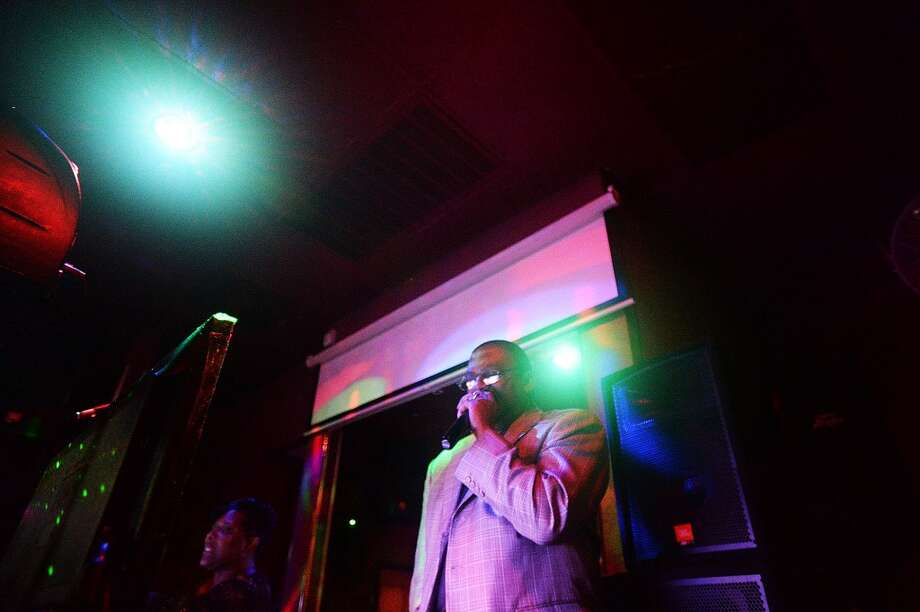 "Robert Turner sings on stage during Karaoke night at Nell""s Place Wednesday night. Michael Rivera/The Enterprise"