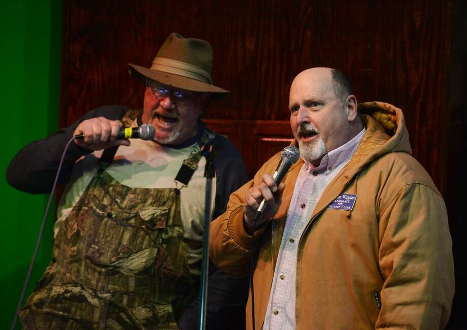 "David Smith, left, and Charlie Wiggins sing Jimmy Buffett's ""Margaritaville"" on Tuesday night. Singers took the stage at Logon Cafe on Tuesday night for karaoke. Photo taken Tuesday, 2/11/14 Jake Daniels/@JakeD_in_SETX"