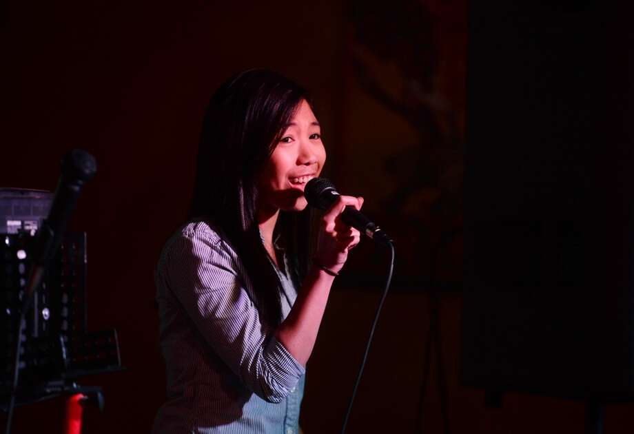 "Kat Nyugen performs Shania Twain's ""That Don't Impress Me Much"" on the karaoke stage at Dylan's on Wednesday. Dylan's Bar and Grill in Port Arthur hosts karaoke on Wednesday nights. Photo taken Wednesday, 2/12/14 Jake Daniels/@JakeD_in_SETX"