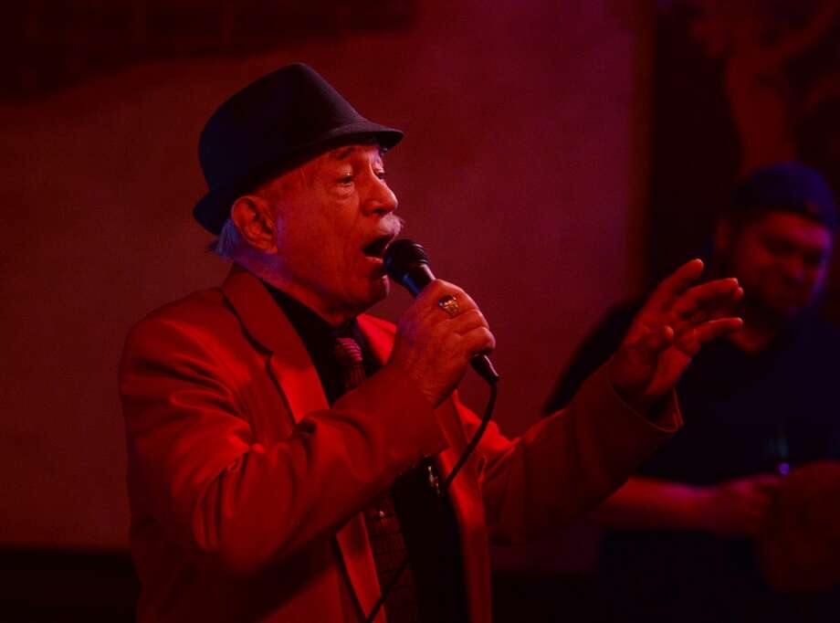 """Tony Alamo performs Frank Sinatra's """"New York, New York"""" during karaoke night at Dylan's on Wednesday. Dylan's Bar and Grill in Port Arthur hosts karaoke on Wednesday nights. Photo taken Wednesday, 2/12/14 Jake Daniels/@JakeD_in_SETX"""