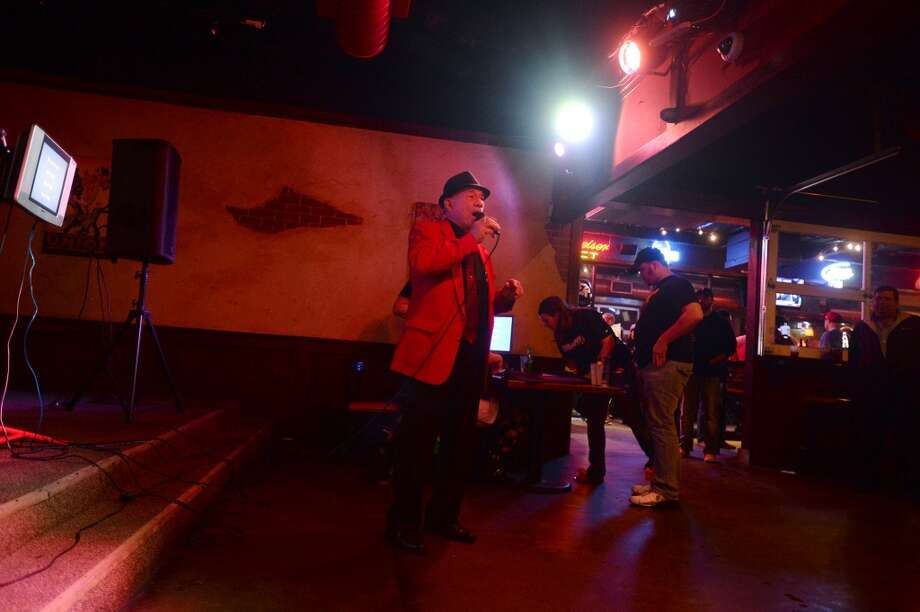 "Tony Alamo performs Frank Sinatra's ""New York, New York"" during karaoke night at Dylan's on Wednesday. Dylan's Bar and Grill in Port Arthur hosts karaoke on Wednesday nights. Photo taken Wednesday, 2/12/14 Jake Daniels/@JakeD_in_SETX"