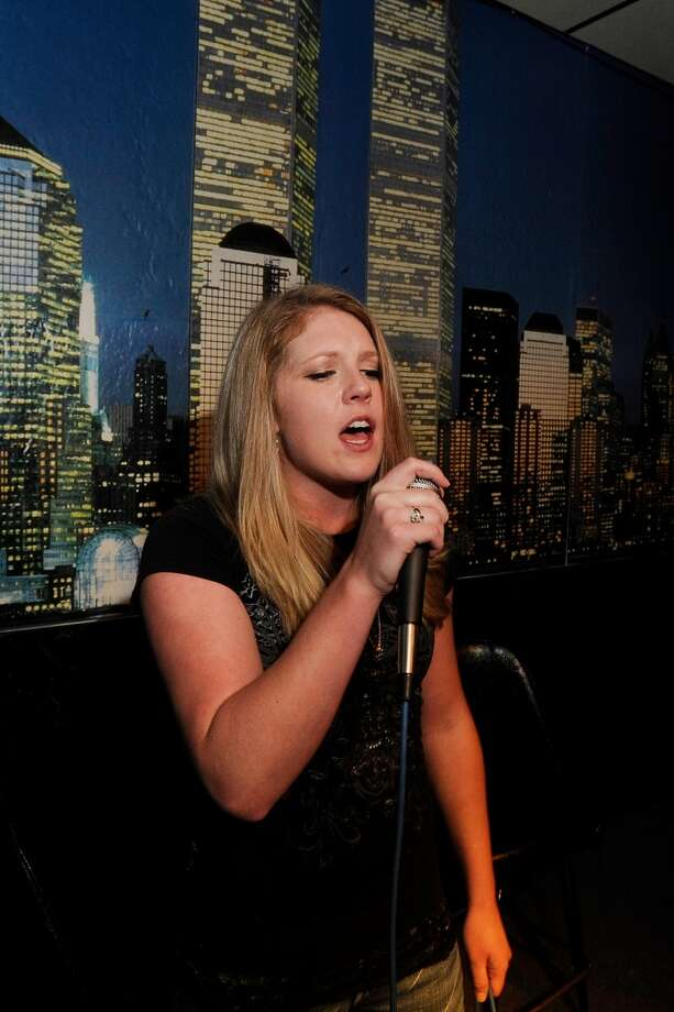 """Jessica Brister of Groves performs the Fleetwood Mac song """"Dreams"""" during karaoke night at Mega Play USA in Port Arthur on Friday.  July 15, 2011.  Valentino Mauricio/The Enterprise Photo: Valentino Mauricio/The Enterpris"""
