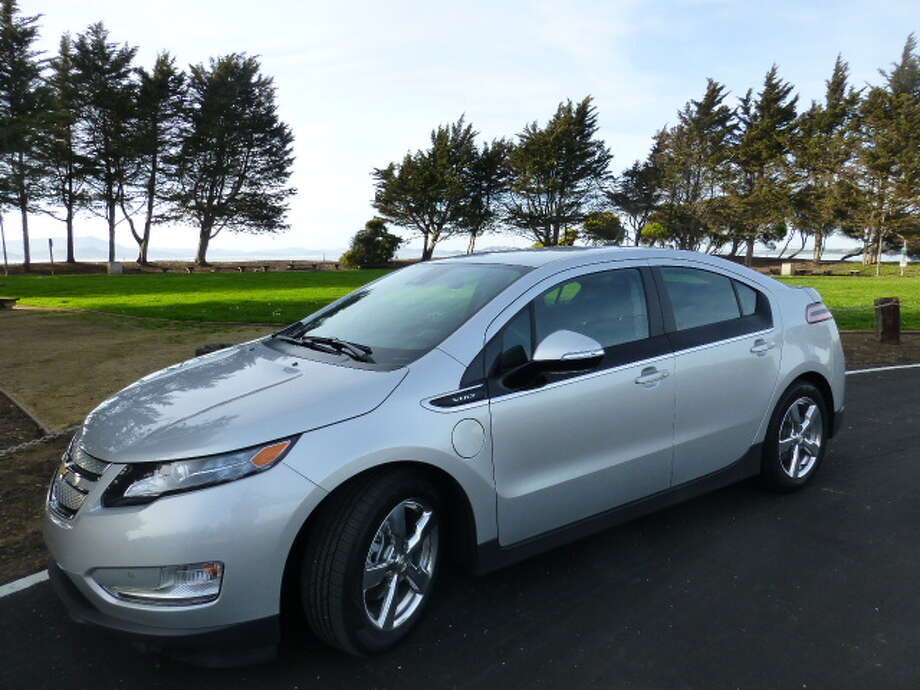 "The 2014 Chevrolet Volt travels about 37 miles on pure electric power. Then its ""range extender"" gasoline-powered engine kicks in to generate electricity for the electric motor. Unlike a hybrid car, the Volt runs only on electric power, not on a combination of electric motor and gasoline engine. (All photos by Michael Taylor)"