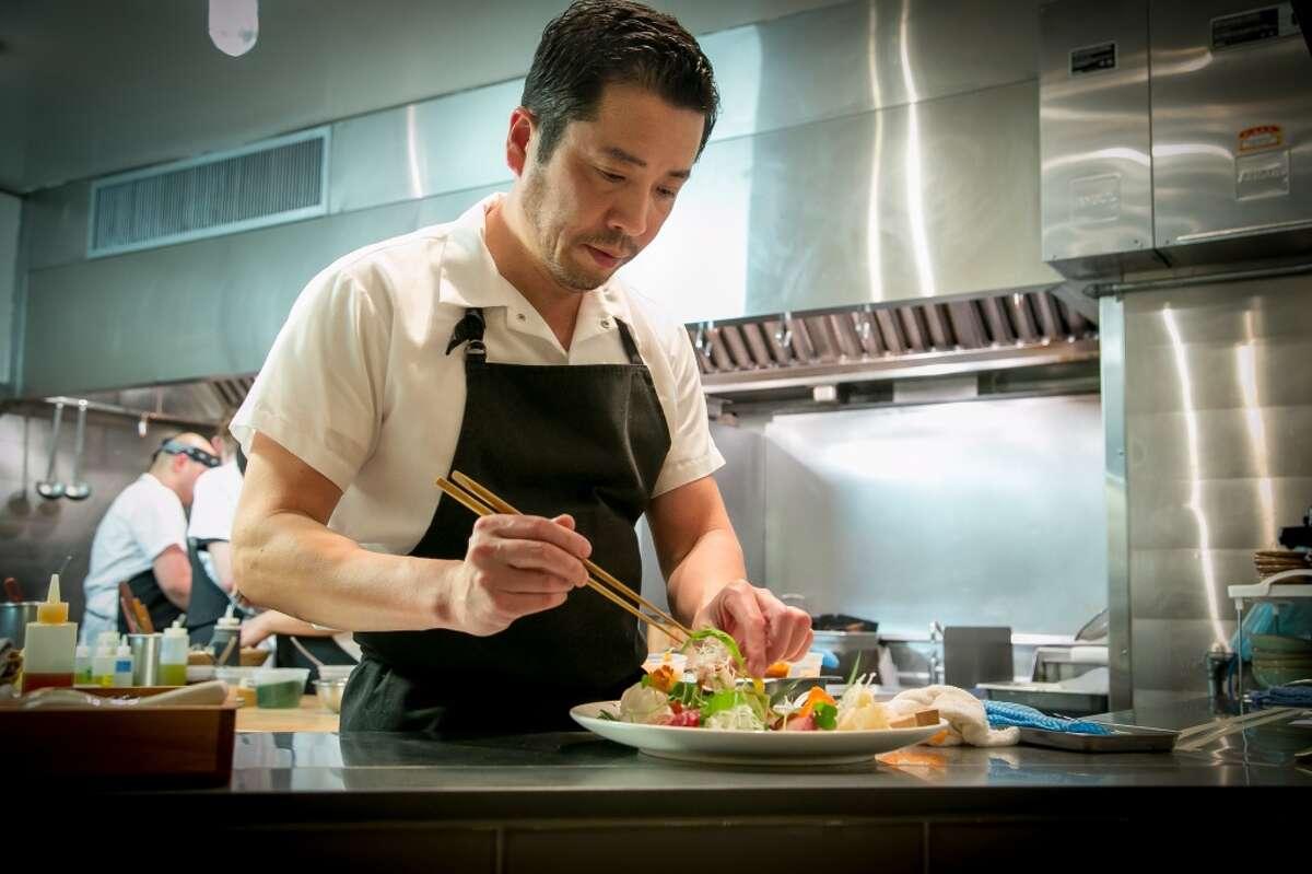 Chef Sho Kamio plates a dish at Iyasare in Berkeley.