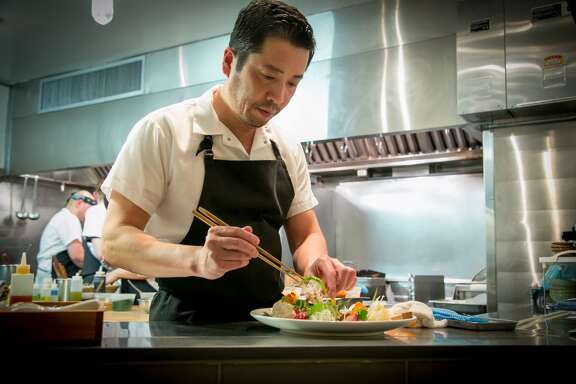 Chef Sho Kamio plates a dish at Iyasare in Berkeley.