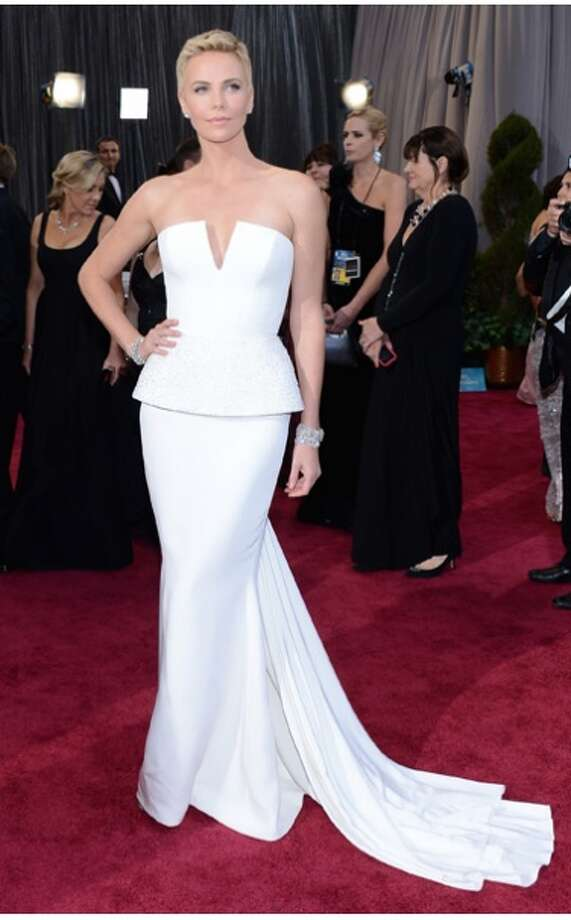 Charlize Theron in Dior, 2013.  White is not an easy color to pull of, especially without looking bridal (Image courtesy of vogue.com)