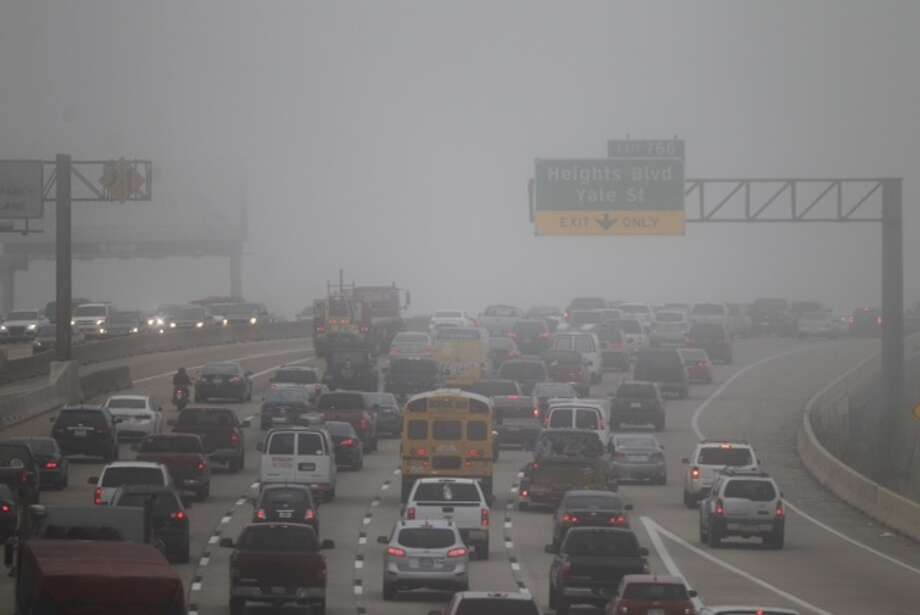 Fog shrouds the Houston area Monday morning. Photo: Cody Duty, Houston Chronicle