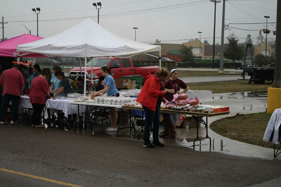 More than 3,500 Southeast Texas residents gathered at a benefit on Sunday at Lumberton High School. The benefit was held to help alleviate funeral arrangement and hospital costs accruing after a fatal crash on Feb. 3 claimed the lives of three and left a Lumberton teacher in the hospital. Funds raised surpassed the initial goal of $25,000 to about $92,000. Photo: Jose D. Enriquez III