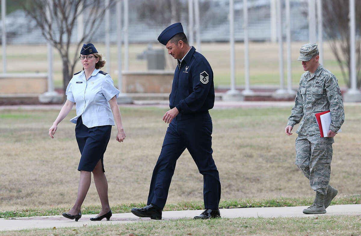U.S. Air Force Master Sgt. Michael Silva, center, leaves an Article 32 hearing at Lackland Air Force, Monday, Feb. 24, 2013. Silva is charged with raping three women over the past 21 years. He faces life in prison if convicted.