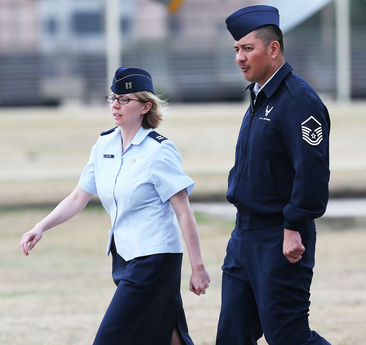 U.S. Air Force Master Sgt. Michael Silva, right, leaves an Article 32 hearing at Lackland Air Force, Monday, Feb. 24, 2013. Silva is charged with raping three women over the past 21 years. He faces life in prison if convicted.