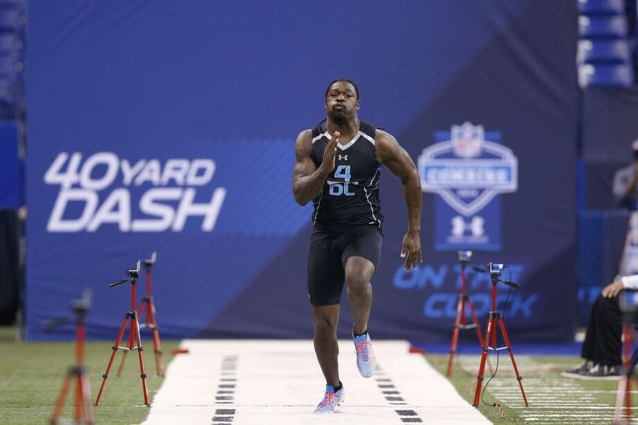 Former South Carolina defensive lineman Jadeveon Clowney runs the 40-yard dash. Photo: Joe Robbins, Getty Images