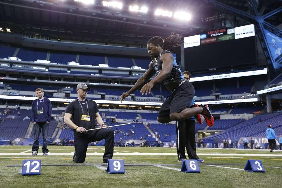 Former South Carolina defensive lineman Jadeveon Clowney takes part in the broad jump. Photo: Joe Robbins, Getty Images