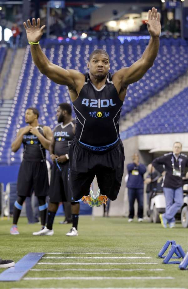 Missouri defensive lineman Michael Sam takes part in the broad jump. Photo: Nam Y. Huh, Associated Press