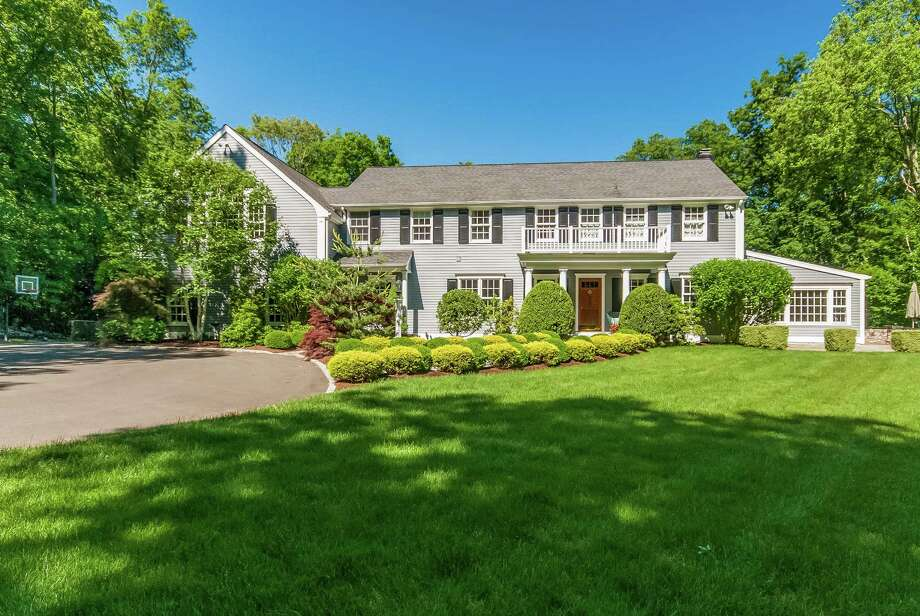 The Colonial at 79 Inwood Road in Darien is situated along a ridge in a private location. It is on the market for $2,495,000. Photo: Contributed Photo, Contributed / Darien News