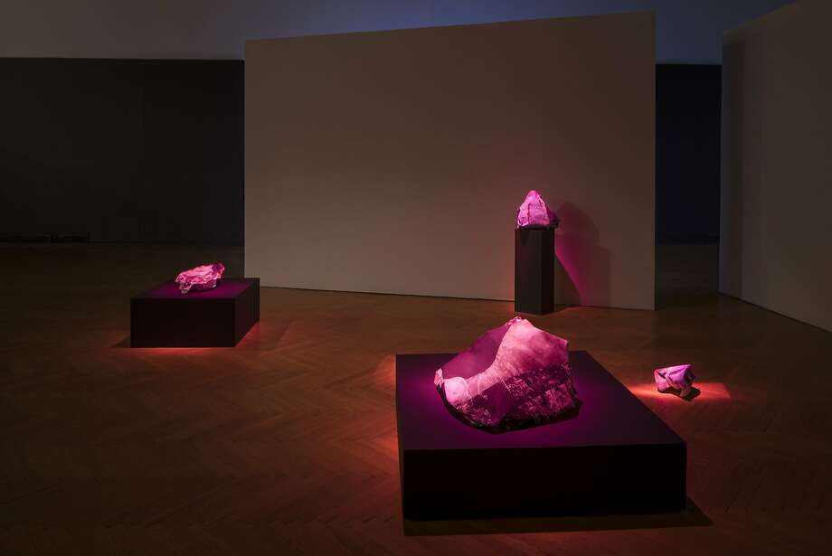 "Anne Colvin's ""A Granite Note"" features a three-channel video installation set among paper rock sculptures. Photo: Www.philbondphoto.com"