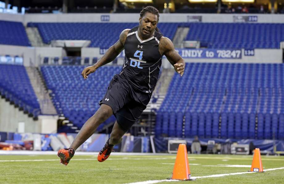 South Carolina defensive lineman Jadeveon Clowney runs a drill. Photo: Michael Conroy, Associated Press