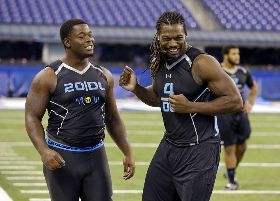 South Carolina defensive lineman Jadeveon Clowney, left, jokes with Florida State defensive lineman Timmy Jernigan. Photo: Michael Conroy, Associated Press