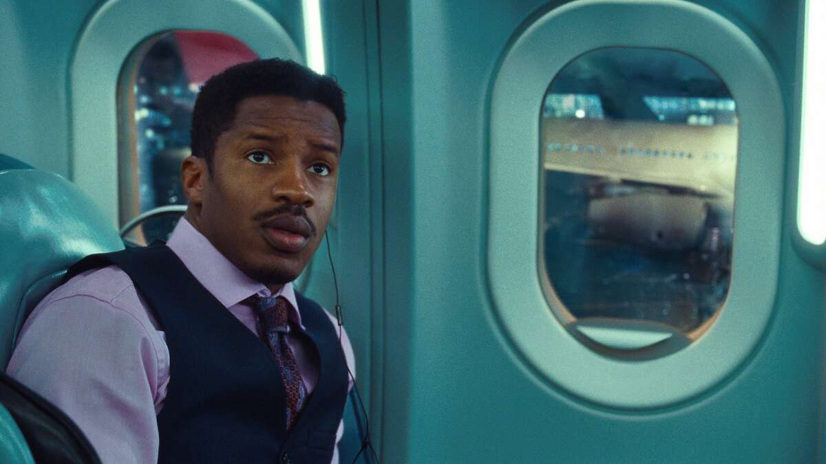 """This image released by Universal Pictures shows Nate Parker in a scene from """"Non-Stop."""" (AP Photo/Universal Pictures)"""