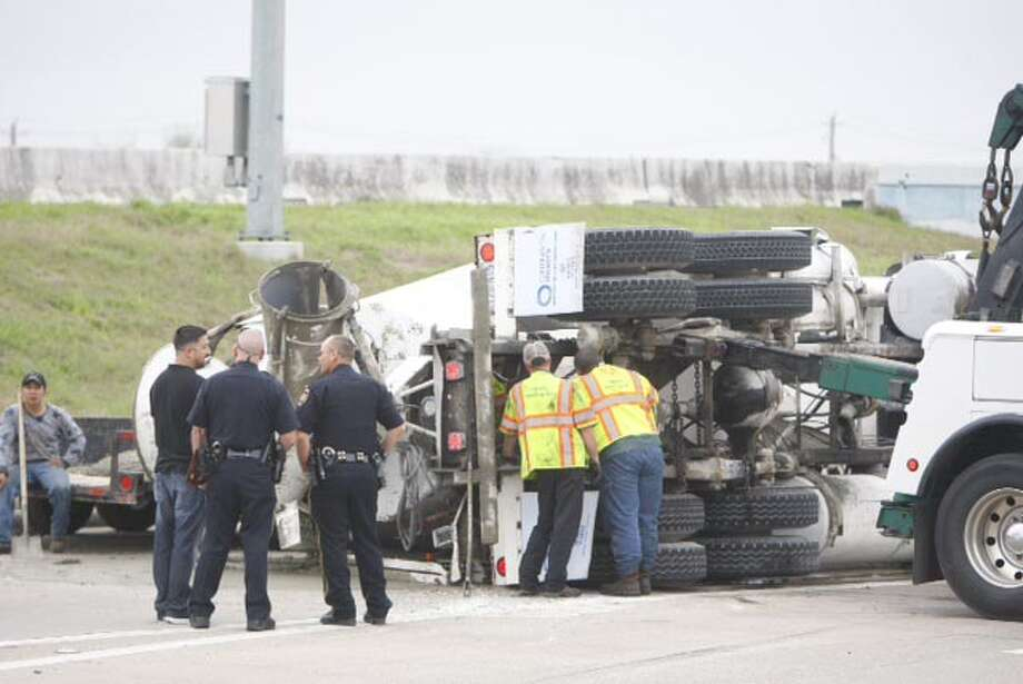 A cement truck overturned northbound on the frontage road of Beltway 8 East near Galveston Road, Monday, Feb. 24, 2014. (Cody Duty / Houston Chronicle) Photo: Cody Duty/Houston Chronicle