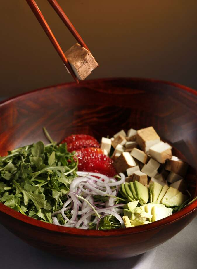 Tofu adds protein to a hearty vegetarian salad with blood orange and sliced avocado. Photo: Craig Lee, Special To The Chronicle