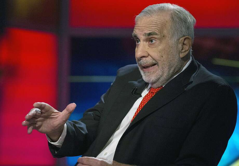 Billionaire activist investor Carl Icahn is stepping up his pressure on eBay to spin off PayPal. Photo: Brendan Mcdermid, Reuters