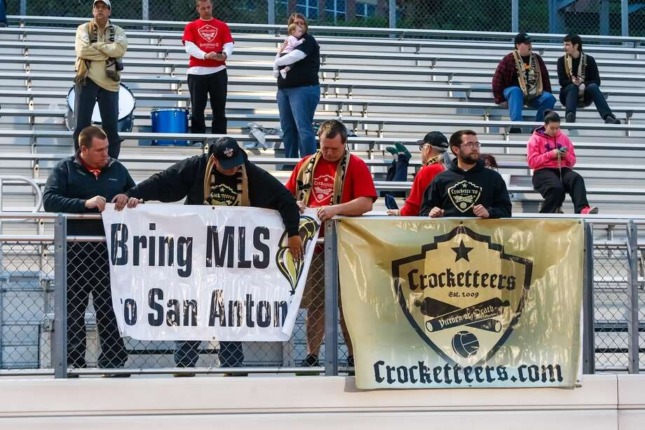 Members of the Crocketteers, a support group for the San Antonio Scorpions, attach their banners to the railing prior to the Scorpions' scrimmage against Incarnate Word at Benson Stadium on Wednesday, March 27, 2013.  The Scorpions won the scrimmage 2-0.  MARVIN PFEIFFER/ mpfeiffer@express-news.net Photo: Marvin Pfeiffer/ Express-News