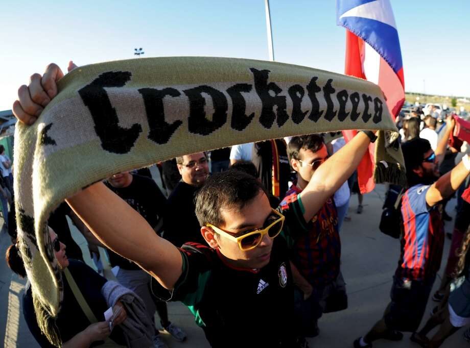 "A member of the San Antonio Scorpions fan club ""The Crocketteers"" holds up his scarf as he enters the stadium before a North American Soccer League (NASL) match between the San Antonio Scorpions and the Fort Lauderdale Strikers on April 21, 2012 a Heroes Stadium in San Antonio Texas. John Albright / Special to the Express-News. Photo: SPECIAL TO THE EXPRESS-NEWS"