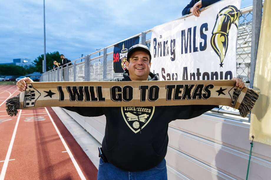 James Hope, President of the Crocketteers, a support group for the San Antonio Scorpions, proudly displays a scarf prior to the Scorpions' scrimmage against Incarnate Word at Benson Stadium on Wednesday, March 27, 2013.  The Scorpions won the scrimmage 2-0.  MARVIN PFEIFFER/ mpfeiffer@express-news.net Photo: Marvin Pfeiffer/ Express-News