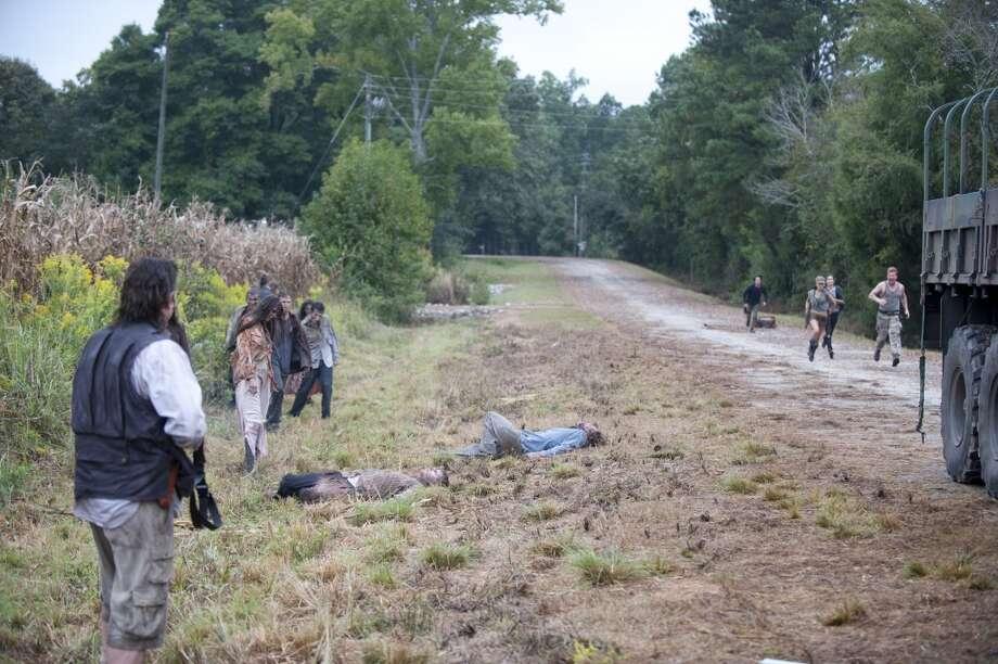 Walkers and Dr. Eugene Porter (Josh McDermitt) - The Walking Dead _ Season 4, Episode 11 - Photo Credit: Gene Page/AMC
