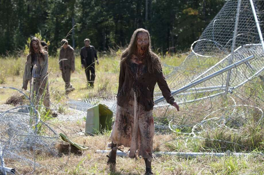 Walkers - The Walking Dead _ Season 4, Episode 11 - Photo Credit: Gene Page/AMC