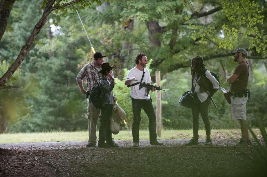 Carl Grimes (Chandler Riggs), Rick Grimes (Andrew Lincoln) and Michonne (Danai Gurira) - The Walking Dead _ Season 4, Episode 11 _ BTS - Photo Credit: Gene Page/AMC