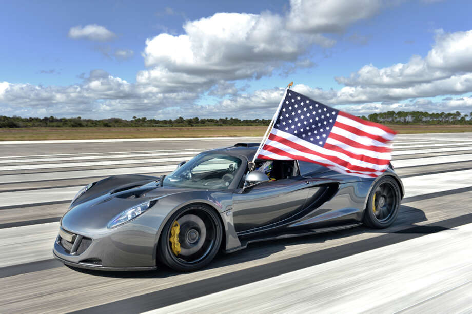 Driver Brian Smith flies Old Glory after setting the world record for the fastest production car ever built in a Hennessey Venom GT. Photo: Hennessey