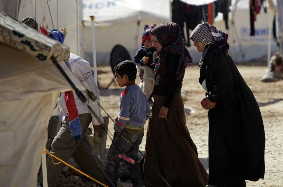 A Syrian family enters a makeshift home in Jordan. Safe havens in Syria can become targets, but they also can be protected. Photo: Mohammad Hannon / Associated Press / AP