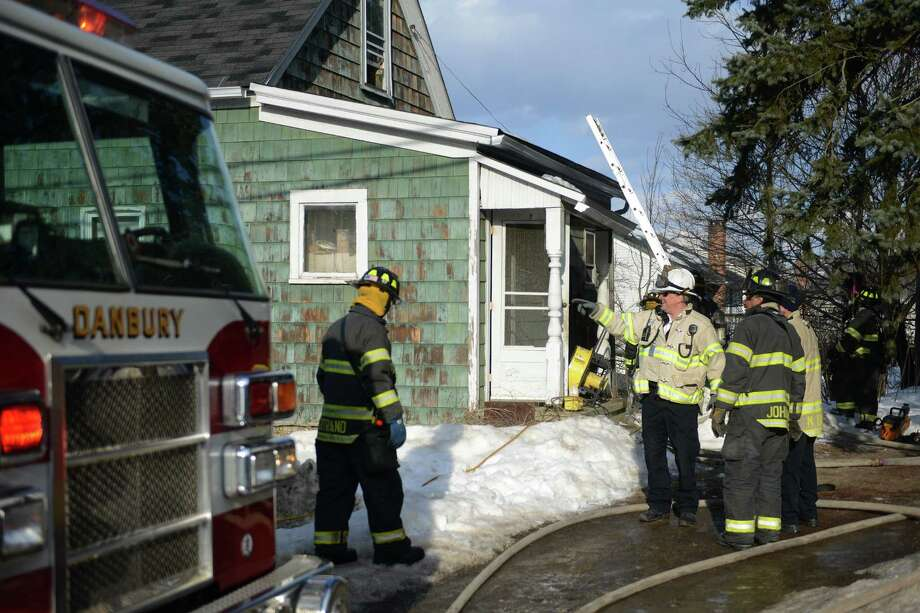 Firefighters respond to a fire on President Street in Danbury, Conn. Monday, Feb. 24, 2014.  An elderly man escaped from the house with minor burns and was taken to Danbury Hospital. Photo: Tyler Sizemore / The News-Times