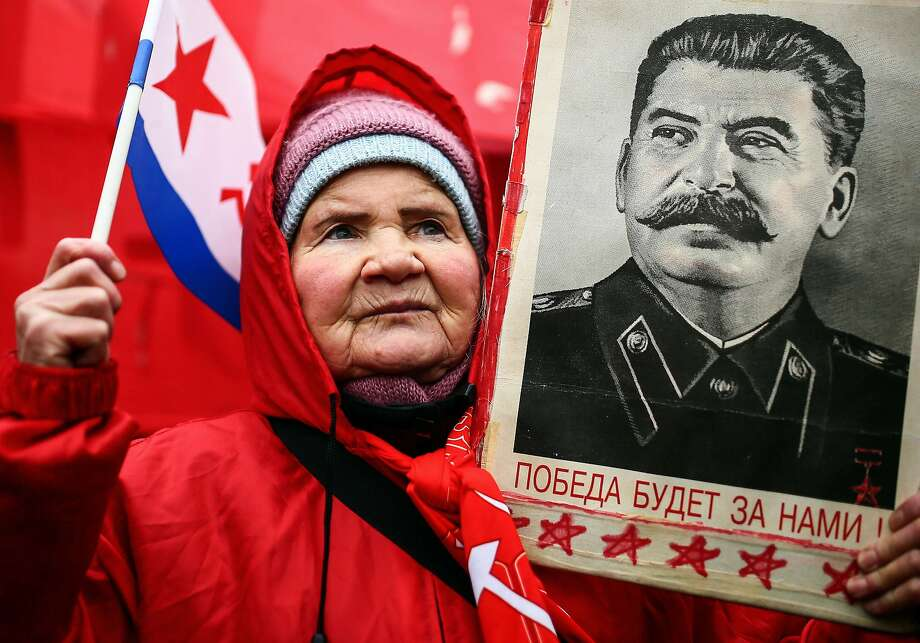I miss Uncle Joe:A Russian Communist holds up a portrait of former Soviet dictator Josef 
