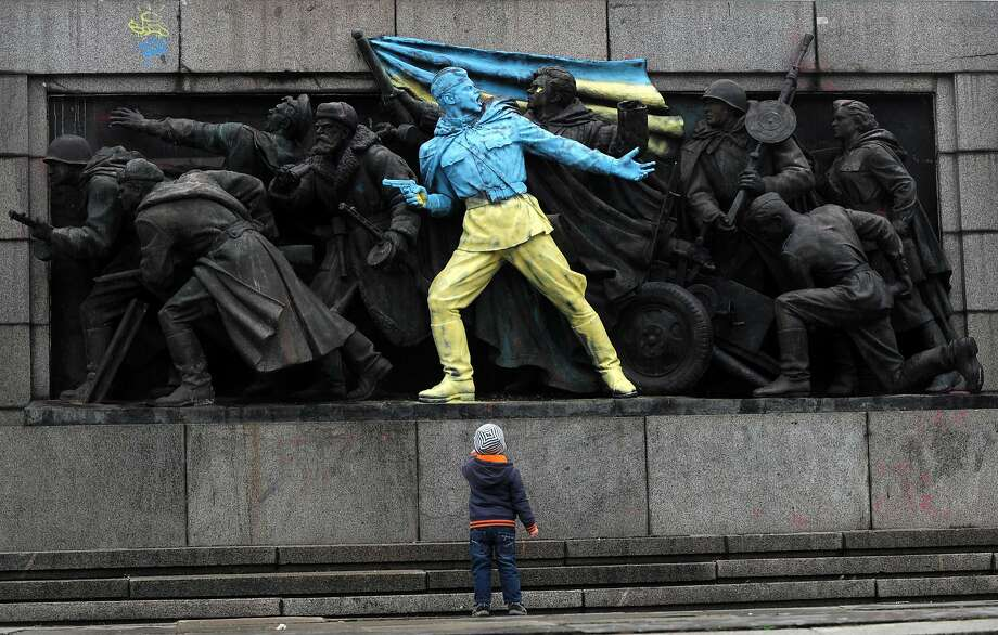 Bulgarian sympathy for Kiev protesters: The Soviet Army World War II monument in central Sofia gets a makeover with one soldier now sporting the national colors of Ukraine. Photo: Nikolay Doychinov, AFP/Getty Images