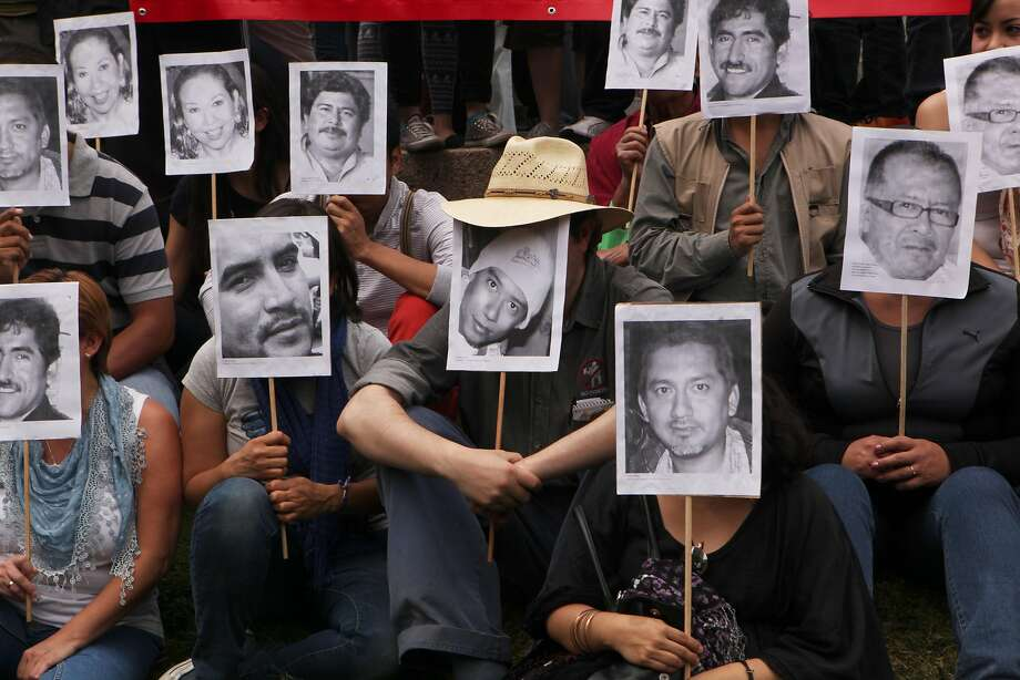 Faces of the slain:Journalists protest the murder of their colleague, Gregorio Jimenez, as well as   the killings of other journalists in Mexico, at the Angel of Independence Monument in   Mexico City. Gunmen kidnapped Jimenez, 42, from his home in   Coatzacoalcos this month. Police found his body buried in the backyard of a home in the   nearby town of Las Choapas along with a taxi driver and a union leader who was kidnapped   in January. Jimenez is at least the 12th journalist slain or to have gone missing since 2010 in Veracruz state. Photo: Marco Ugarte, Associated Press