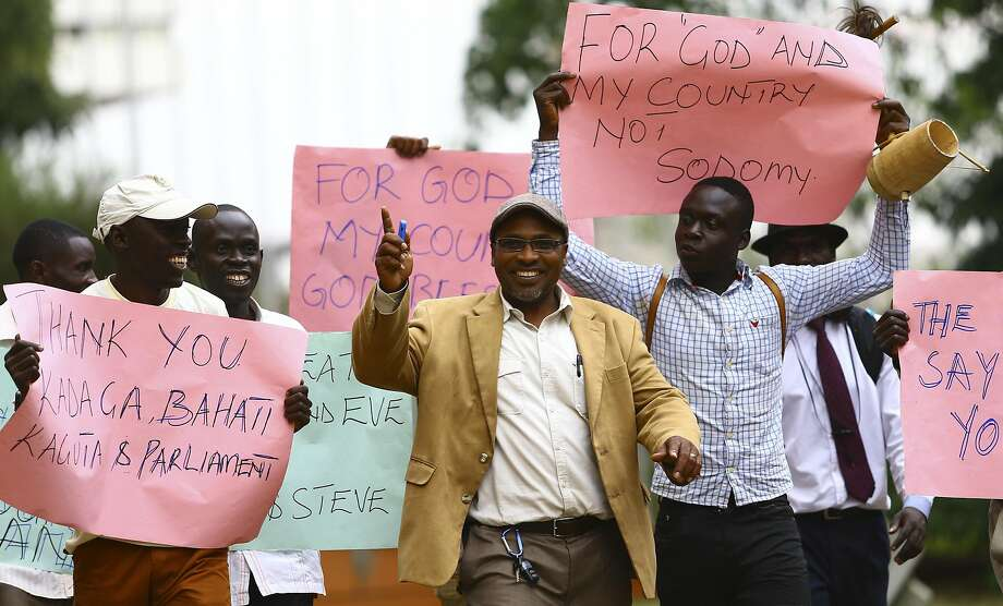 Ugandan antigay activist Pastor Martin Ssempa (center) leads supporters as they celebrate in the capital, Kampala, after President Yoweri Museveni signed a law imposing harsh penalties for homosexuality. Photo: Stringer, Reuters