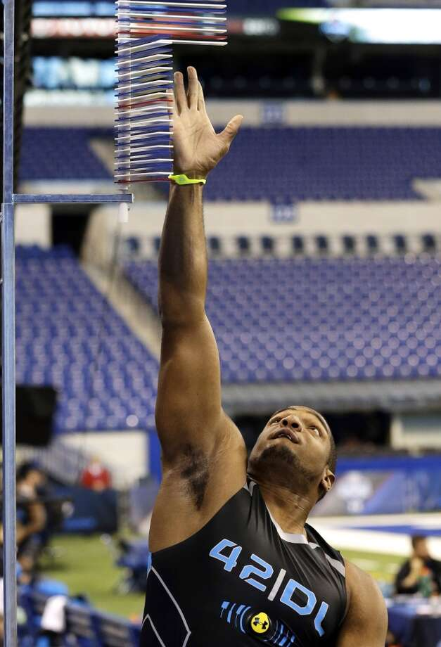Missouri defensive lineman Michael Sam reaches during a vertical leap attempt. Photo: Nam Y. Huh, Associated Press