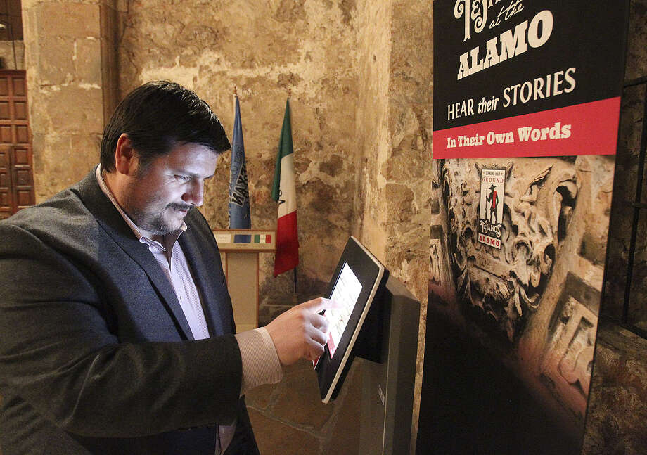 "Dr. Jose Barragan demonstrates an audio information station where visitors will hear the story of Tejano defenders in ""Standing Their Ground: Tejanos at the Alamo."" Photo: Tom Reel / San Antonio Express-News / San Antonio Express-News"