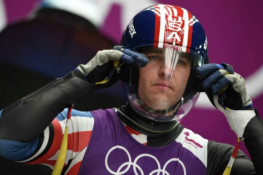 Christian NiccumSport: LugeAge: 36Results: 6th place (men's team relay), 11th place (men's doubles luge)Local connection: Grew up in Seattle and now lives with his family in Woodinville. Photo: LEON NEAL, AFP/Getty Images / 2014 AFP