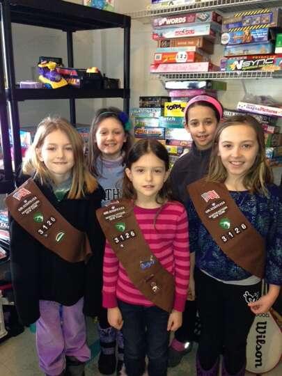 Division Street Elementary School second-graders Theresa Prehn, Maggie Pendergast, Anna Sheinkin, Zo